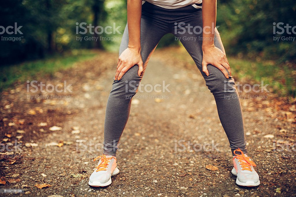 Woman resting after running stock photo