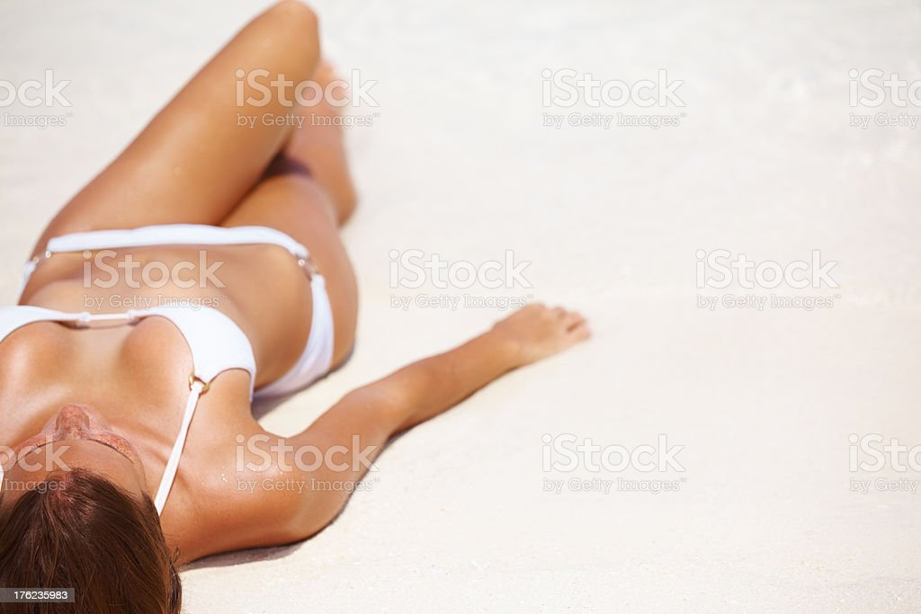 Woman resting at beach stock photo