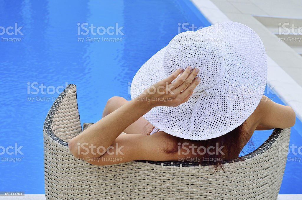 Woman resting at the pool stock photo