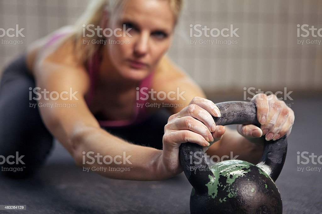 Woman Resting During Kettlebell Workout royalty-free stock photo