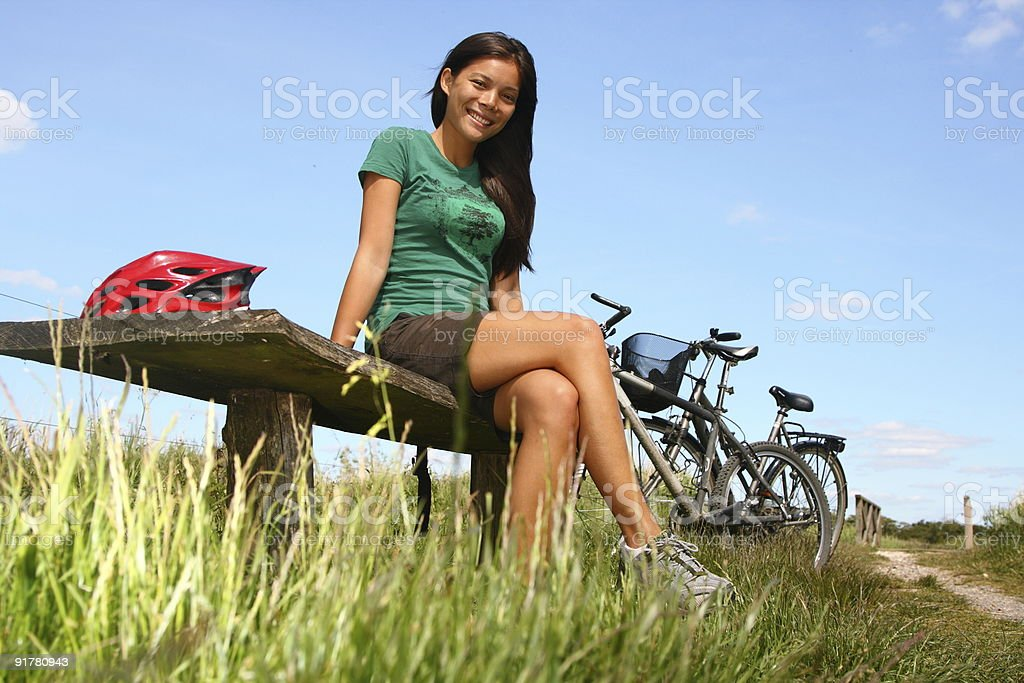 Woman resting from biking royalty-free stock photo