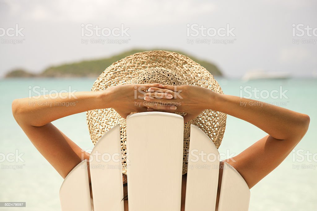 woman resting in beach chair looking at the Caribbean views stock photo