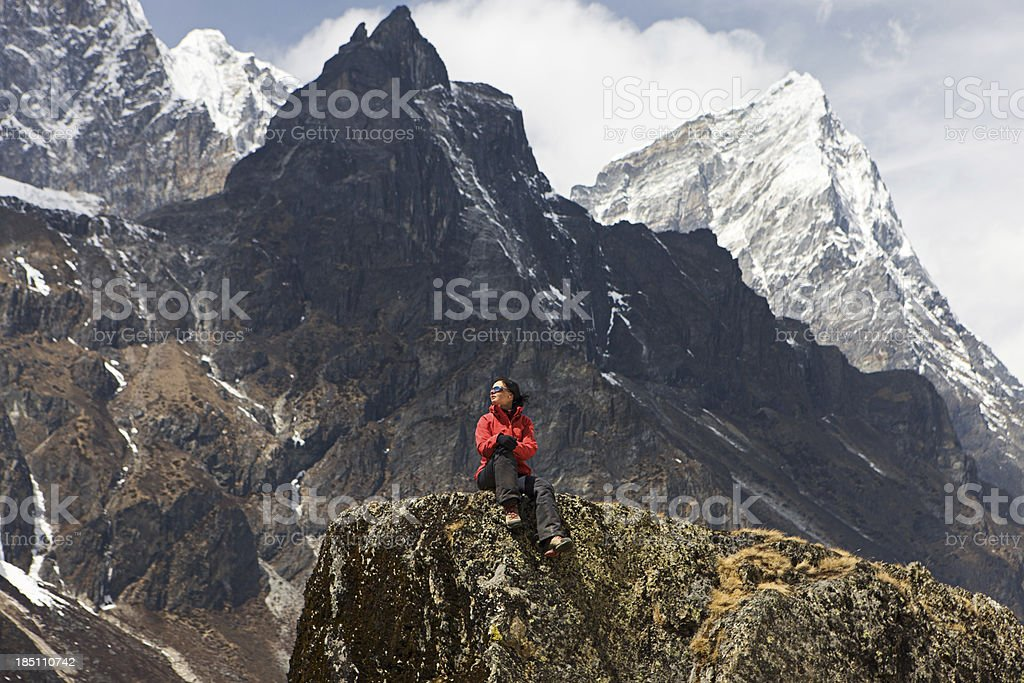 Woman resting in Himalayas, Mount Everest National Park royalty-free stock photo