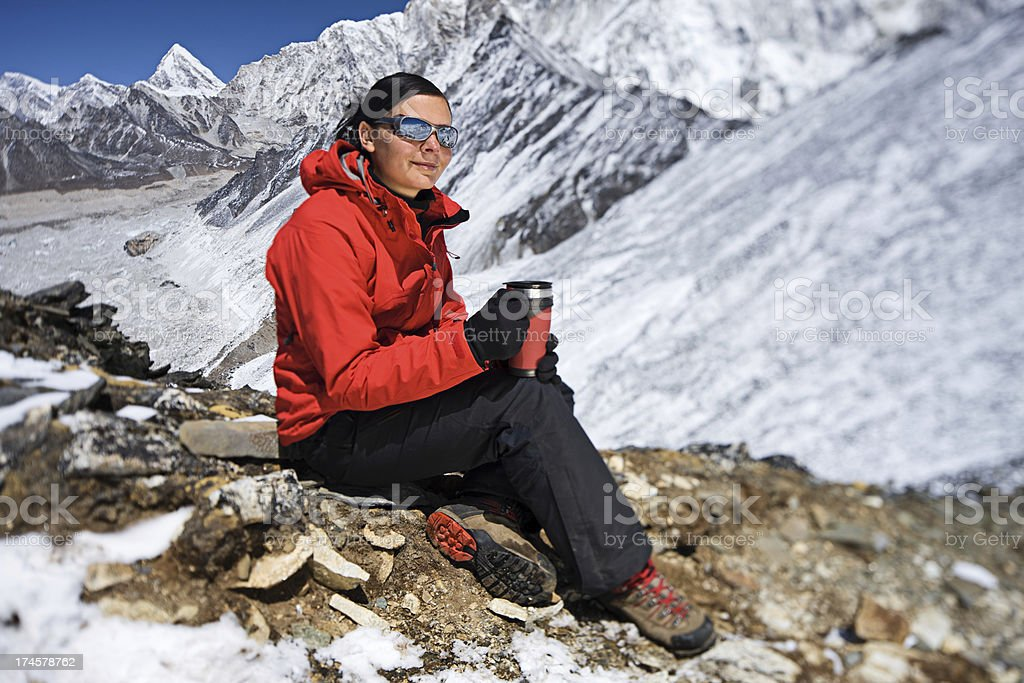 Woman resting in  Mount Everest National Park, Nepal royalty-free stock photo