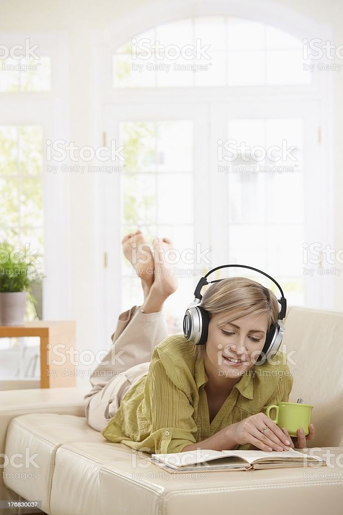 Woman resting on couch at home royalty-free stock photo