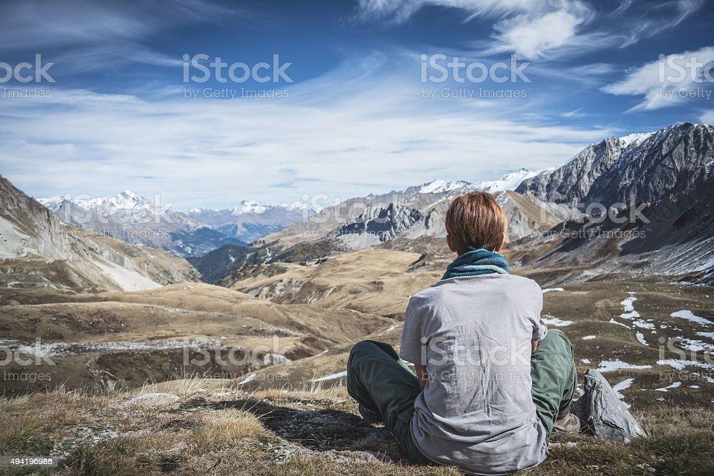 Woman resting on the mountain summit stock photo