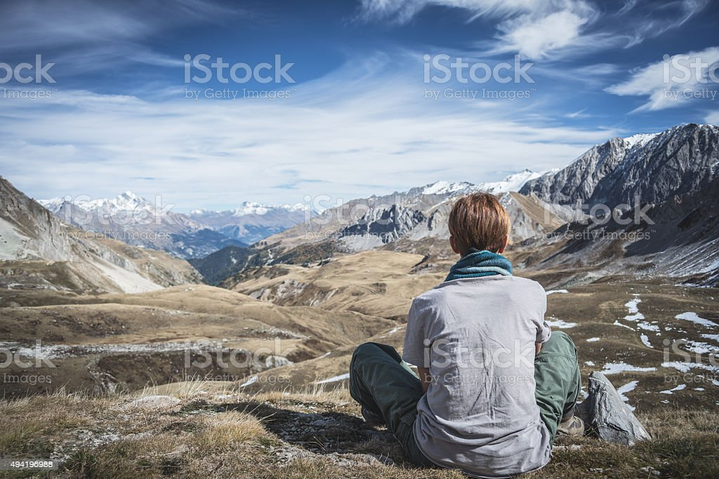 Woman resting on the mountain summit stock photo