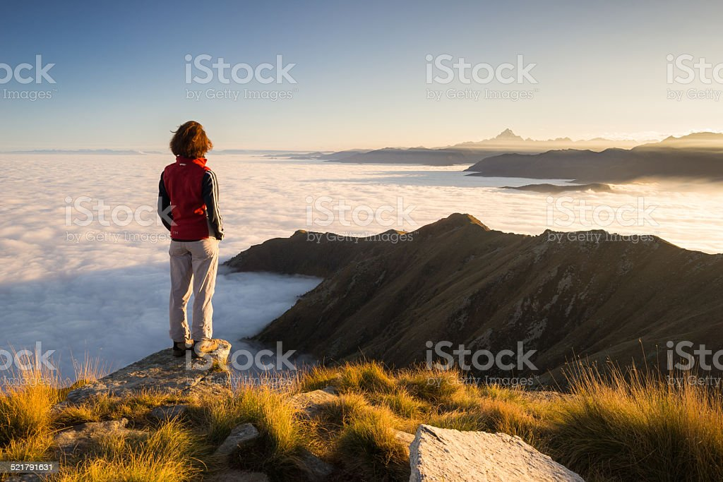 Woman resting on the mountain top stock photo
