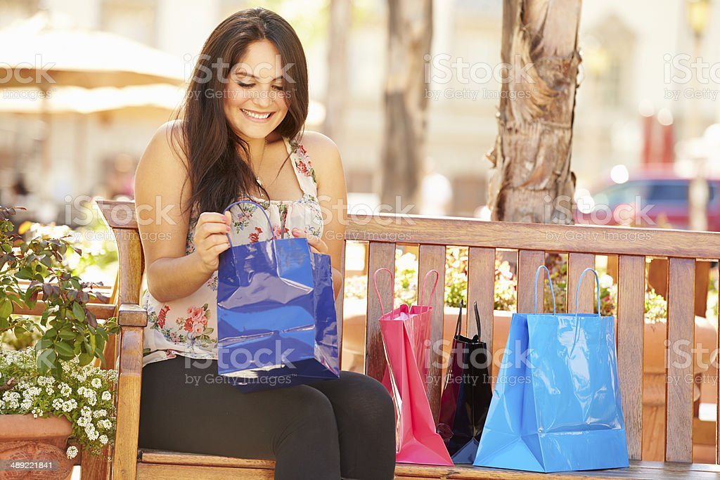 Woman Resting With Shopping Bags Sitting In Mall royalty-free stock photo
