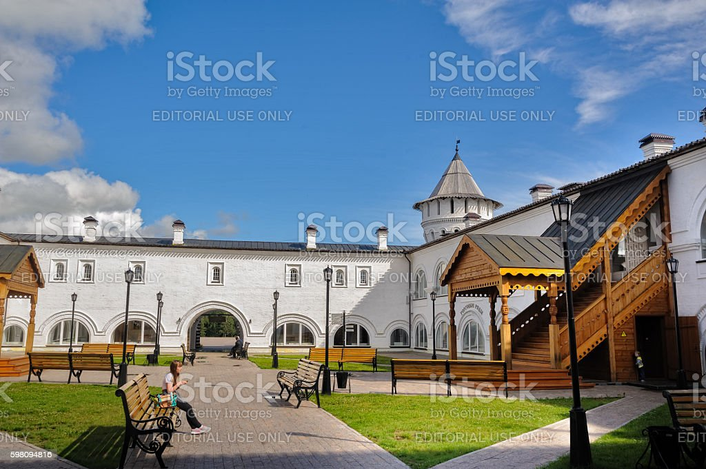 Woman rests in interior of Guest Yard. Tobolsk stock photo