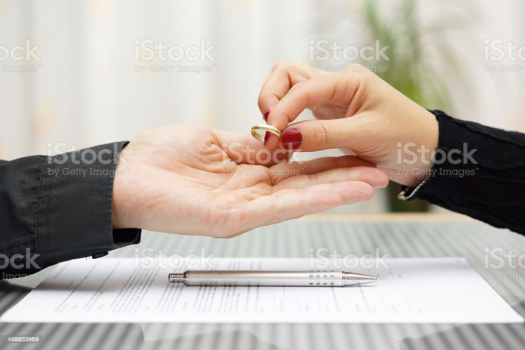 woman returned wedding ring to  husband . Divorce concept stock photo