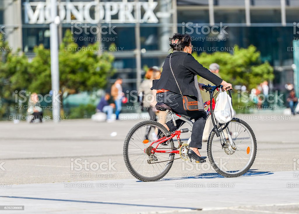 woman ride a bike in town. Alternative ecological transport stock photo