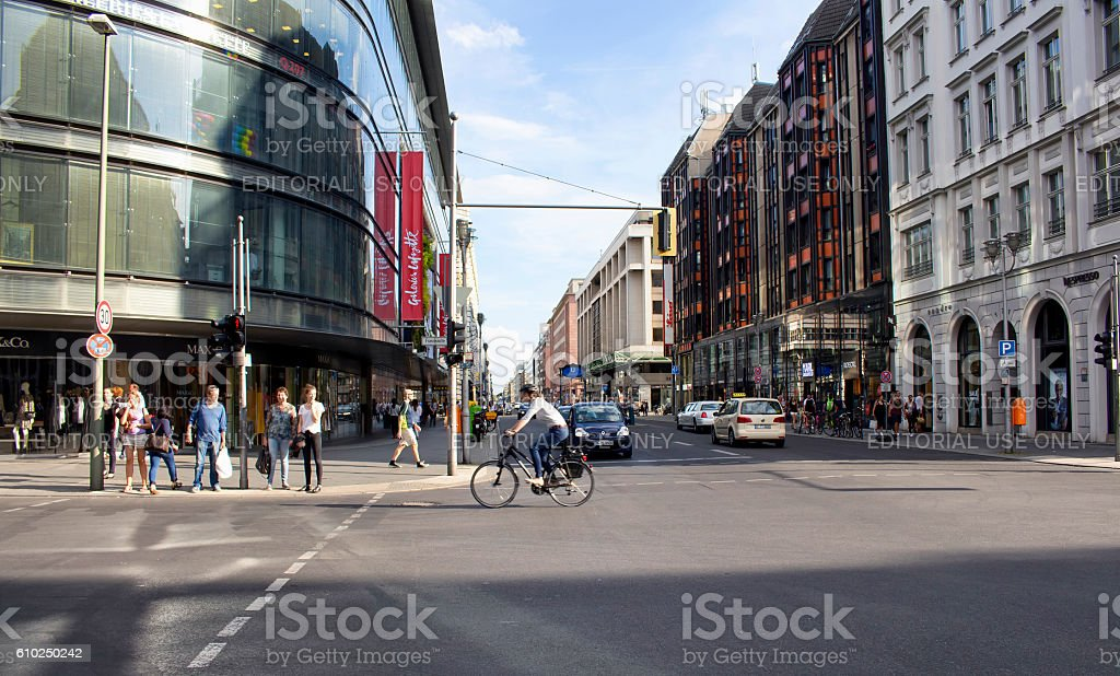 Woman rides bicycle in blurry motion stock photo