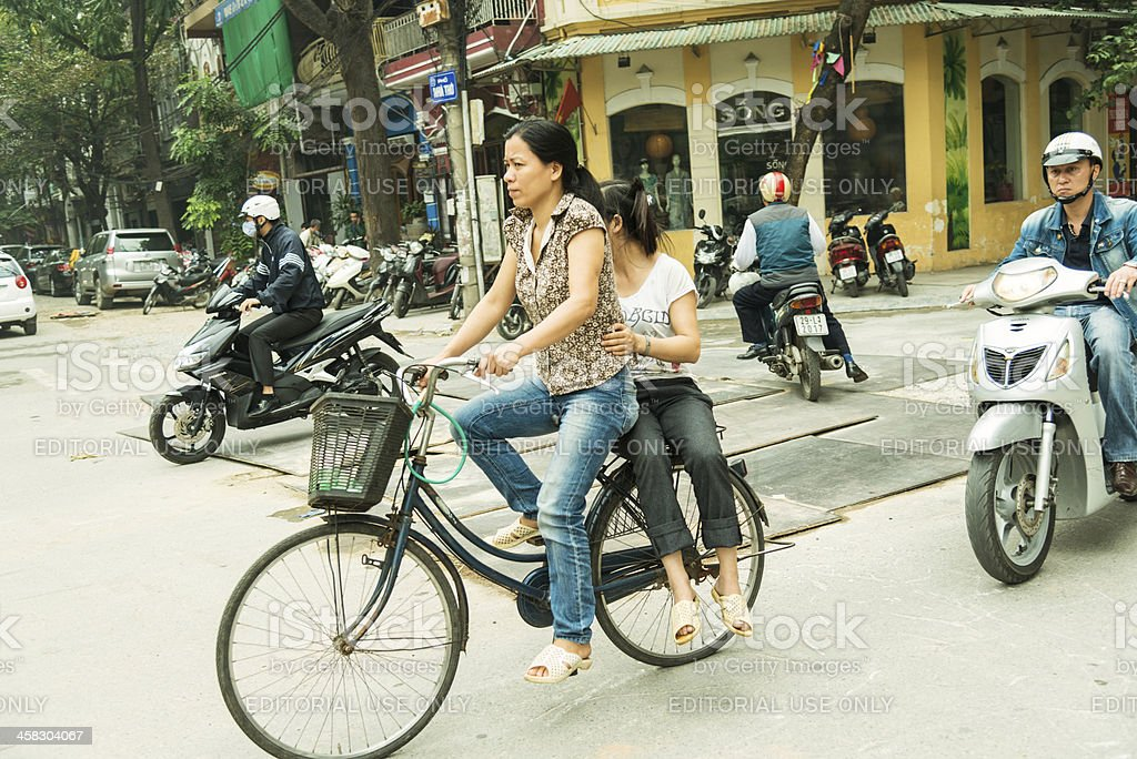 Woman Riding A Bicycle in Hanoi, Vietnam stock photo