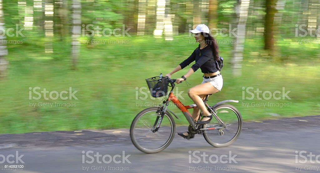 Woman riding a bicycle stock photo