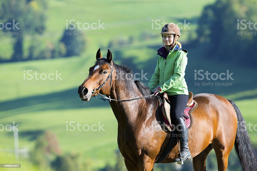 Woman riding a horse royalty-free stock photo