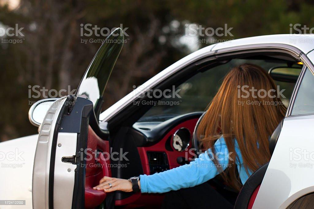 Woman riding a sports car royalty-free stock photo