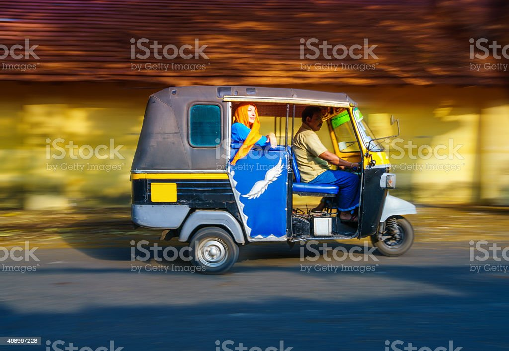 Woman riding a tuk tuk taxi stock photo