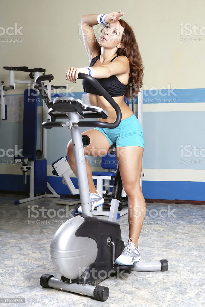 Woman Riding Bicycle at Gym royalty-free stock photo
