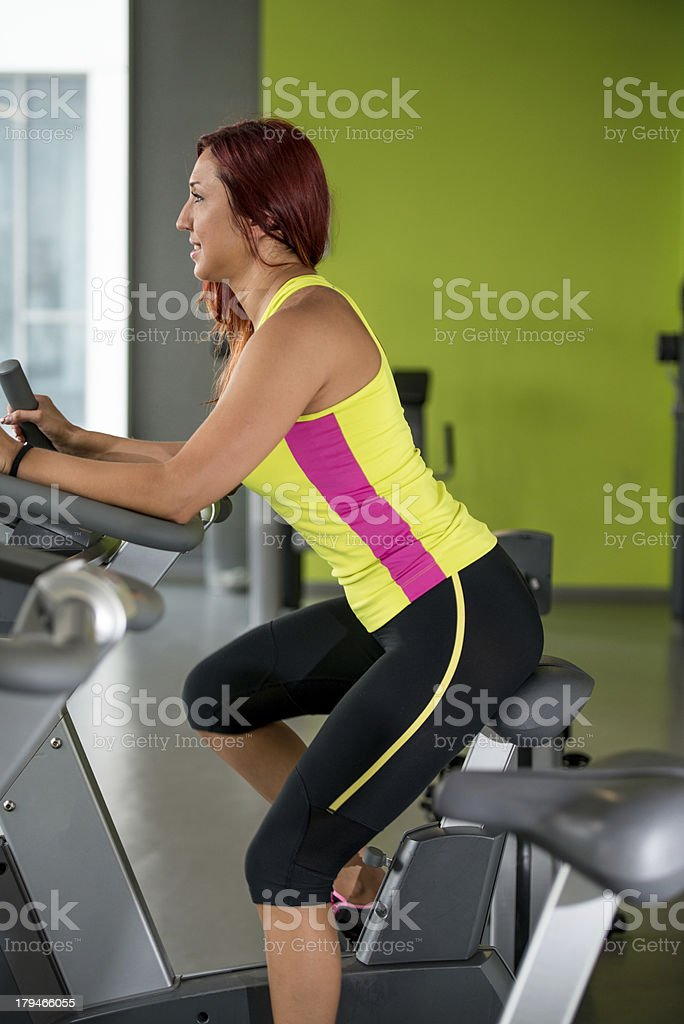 Woman riding bicycle royalty-free stock photo