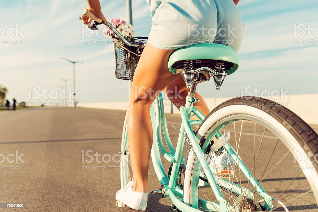 Woman riding bicycle. stock photo