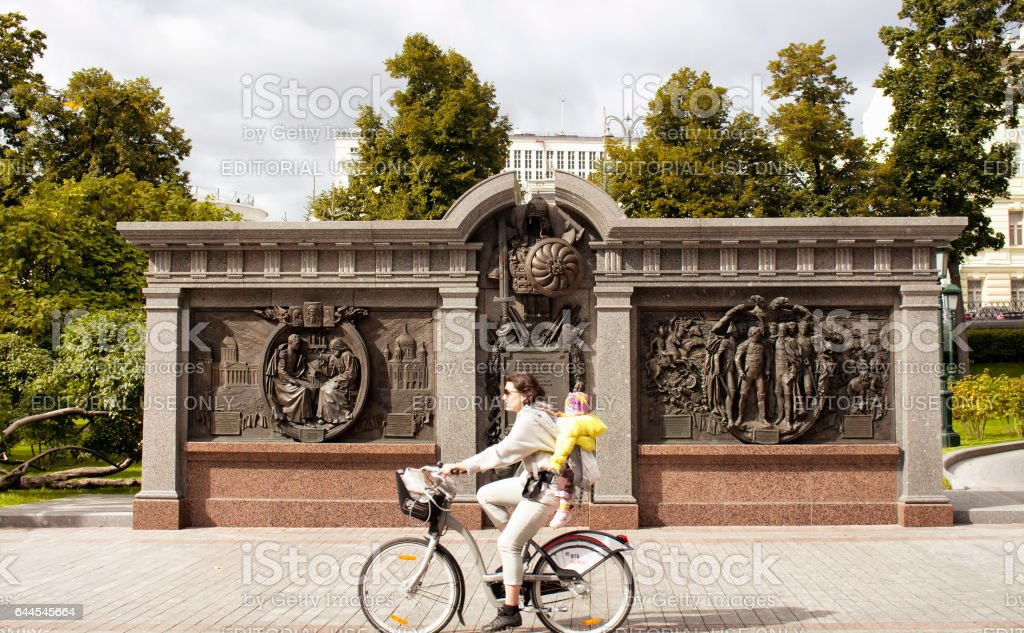 Woman riding bicycle with her daughter stock photo