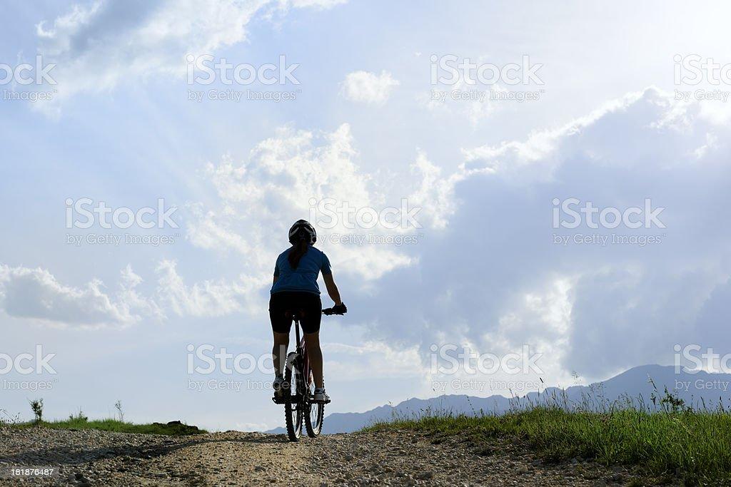 woman riding bike royalty-free stock photo