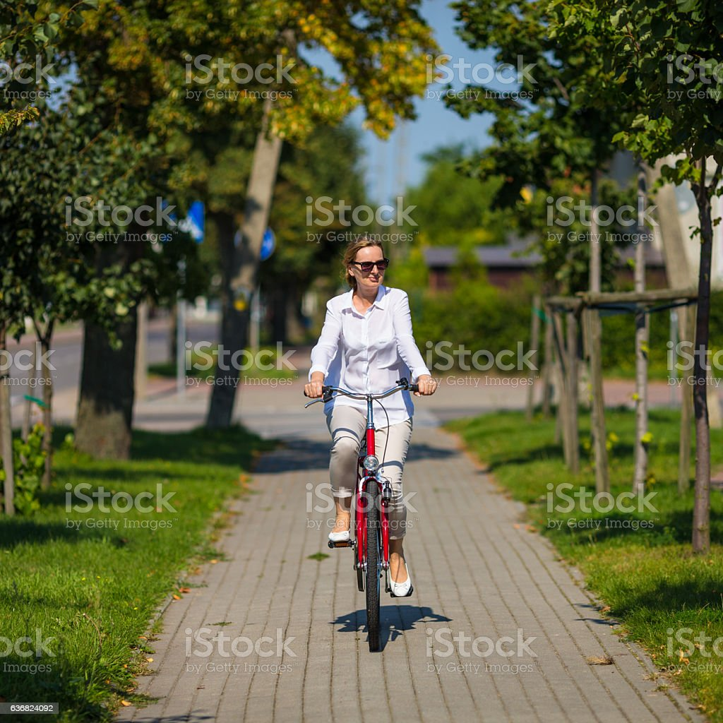 Woman riding bike stock photo