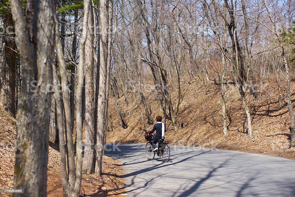 Woman riding bikes during springtime stock photo