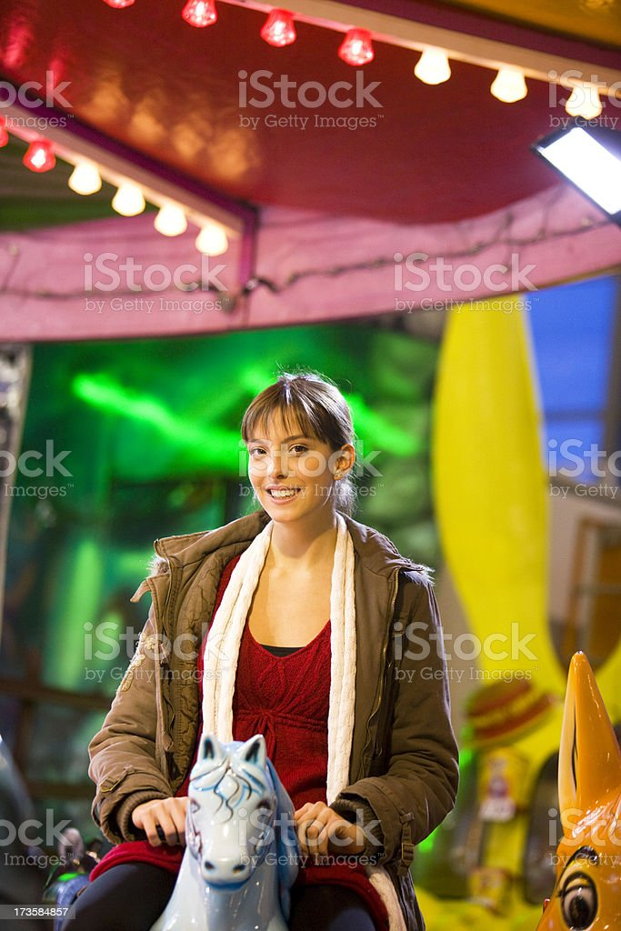 Woman riding carousel horse royalty-free stock photo
