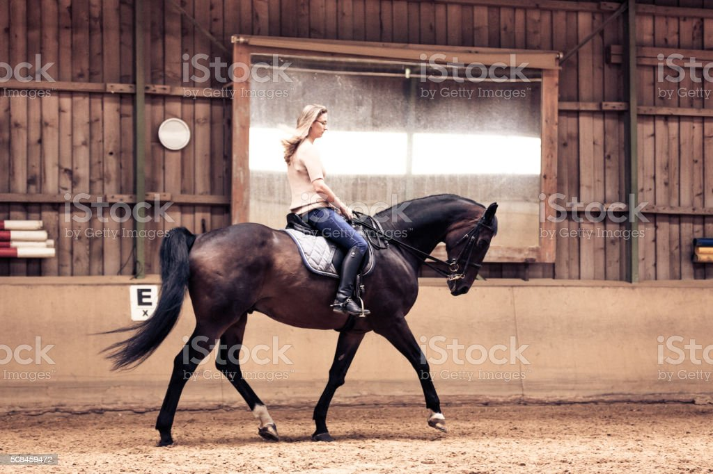 Woman Riding Her Horse stock photo