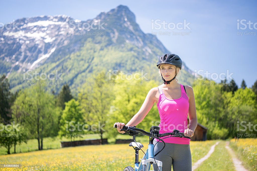 Woman riding her Mountainbike on a Trail, Austrian Alps stock photo