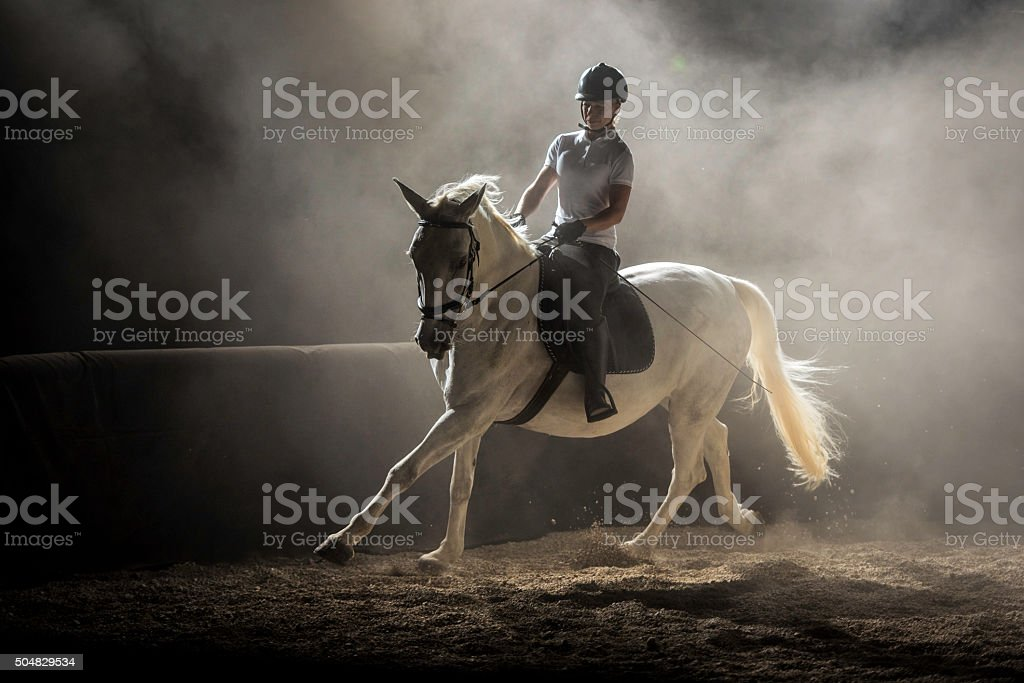 Woman riding horse stock photo