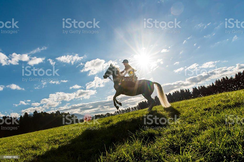Woman riding horse stock photo