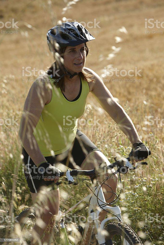 Woman riding mountain bike royalty-free stock photo