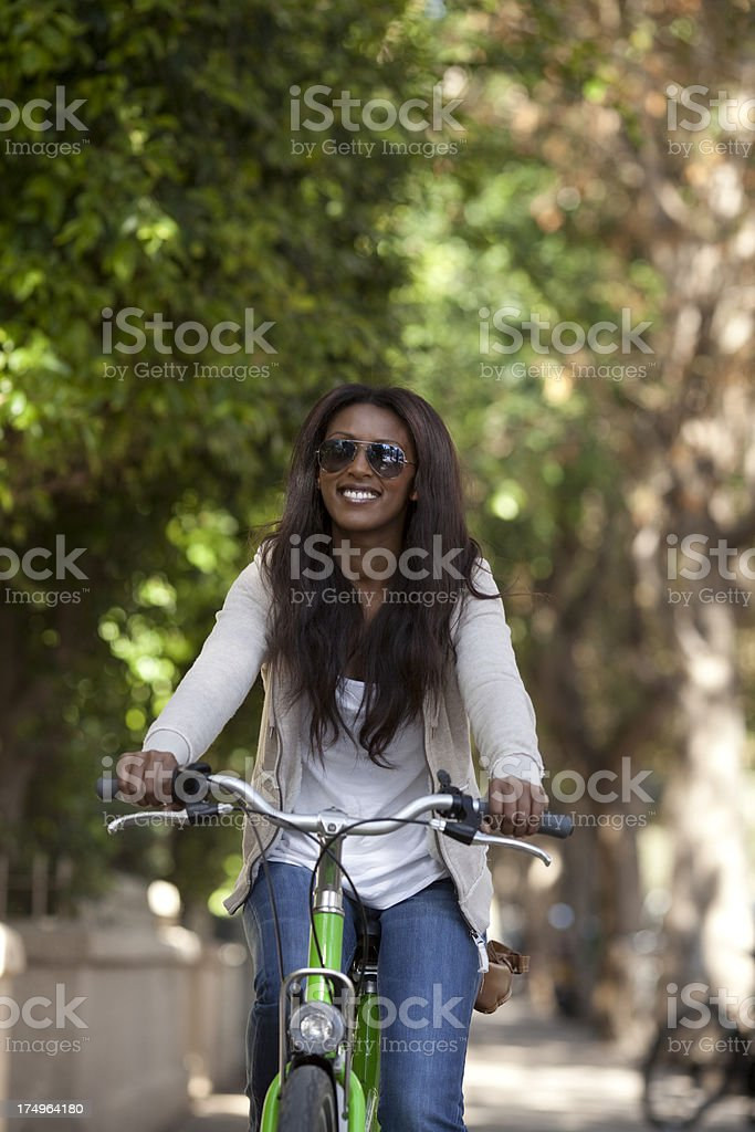 Woman riding on a  bicycle. royalty-free stock photo