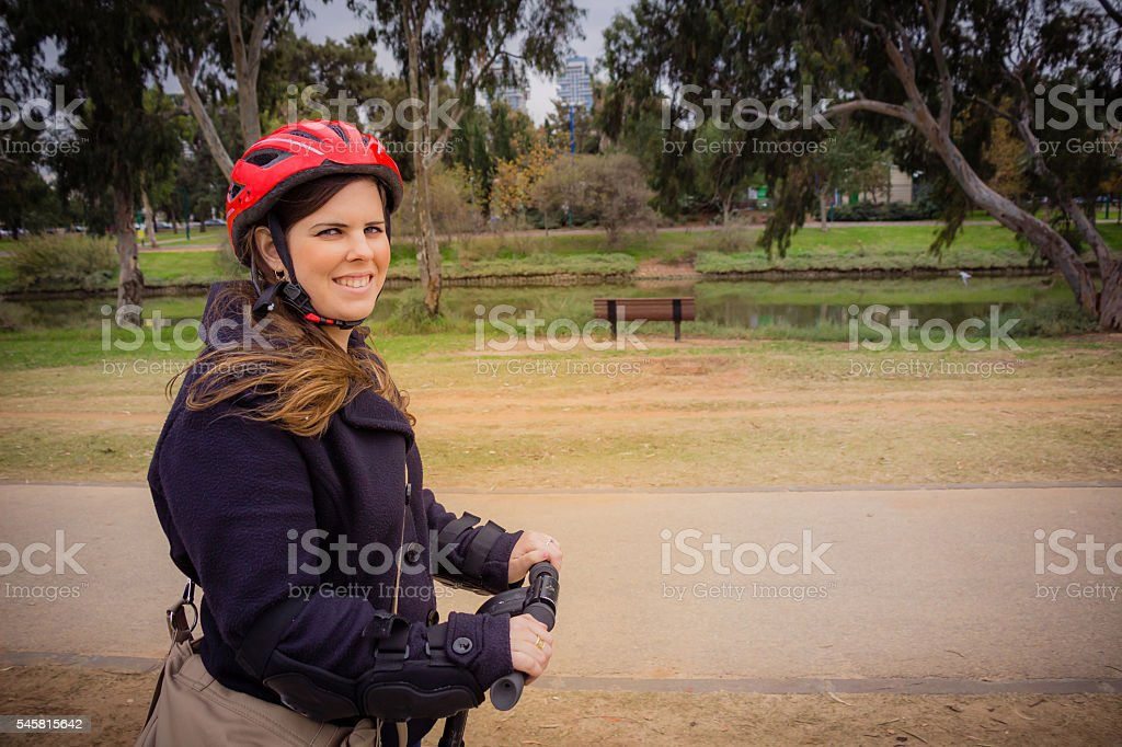 Woman riding on a Segway in the park stock photo