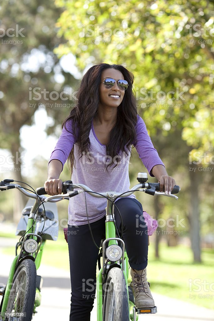Woman riding on bicycle. royalty-free stock photo