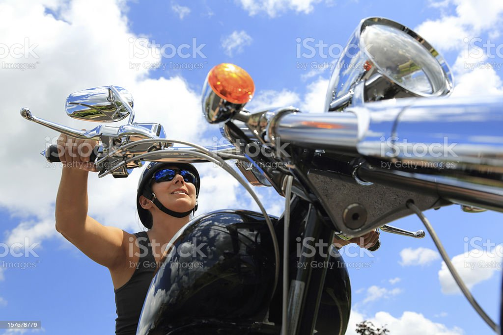 Woman Riding On Motorcycle In A Beautiful Summer Day stock photo