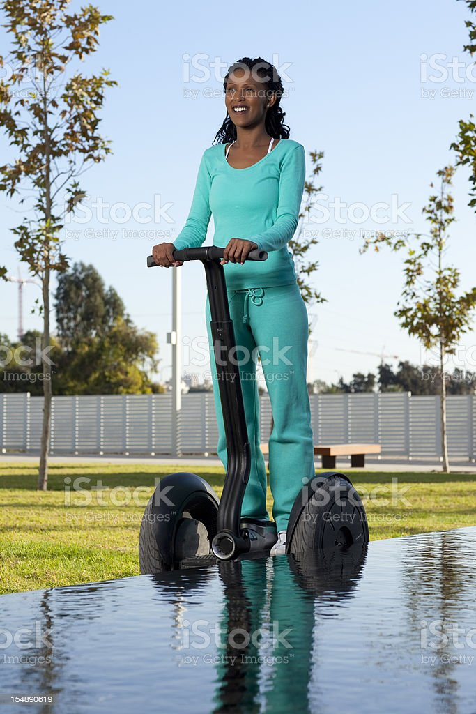 Woman riding on segway. royalty-free stock photo