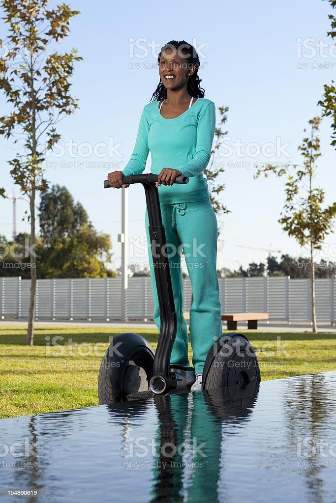 Woman riding on segway. stock photo