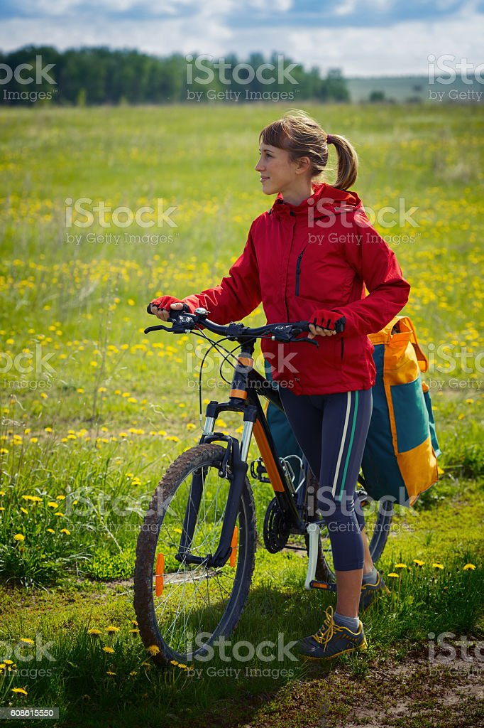Woman riding the bicycle stock photo