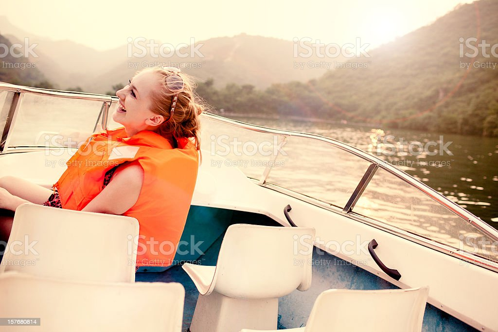 Woman riding the boat royalty-free stock photo