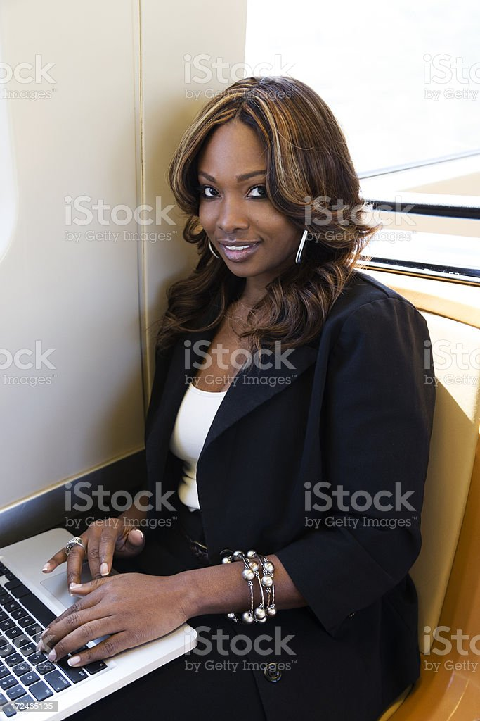 Woman Riding the Train with Laptop royalty-free stock photo