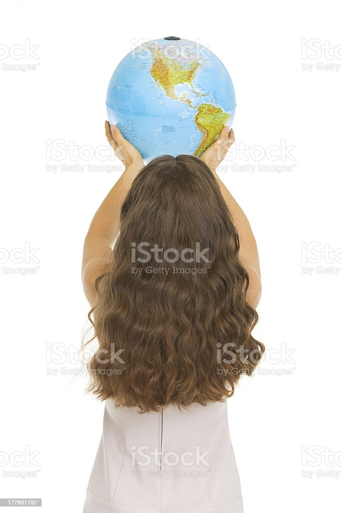 Woman rising earth globe . rear view royalty-free stock photo