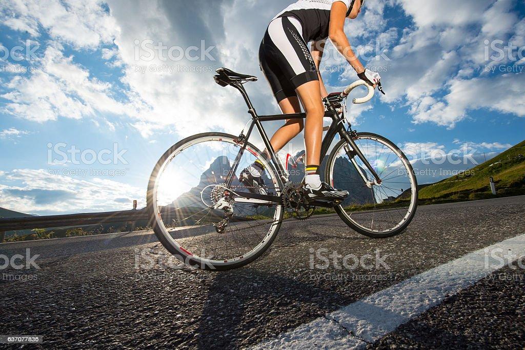 woman road cycling tour stock photo