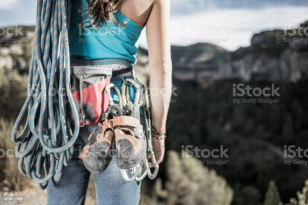 Woman rock climber with equipment stock photo