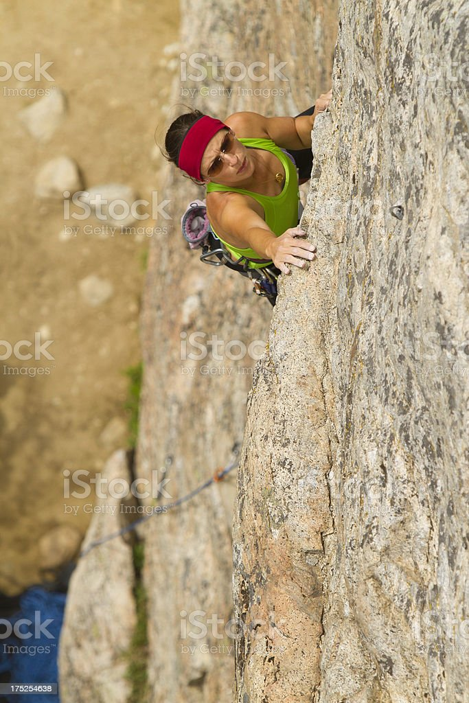 Woman Rock Climbing stock photo