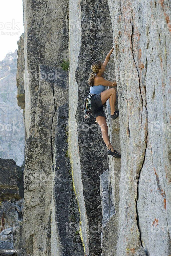 Woman rock climbing#2 royalty-free stock photo