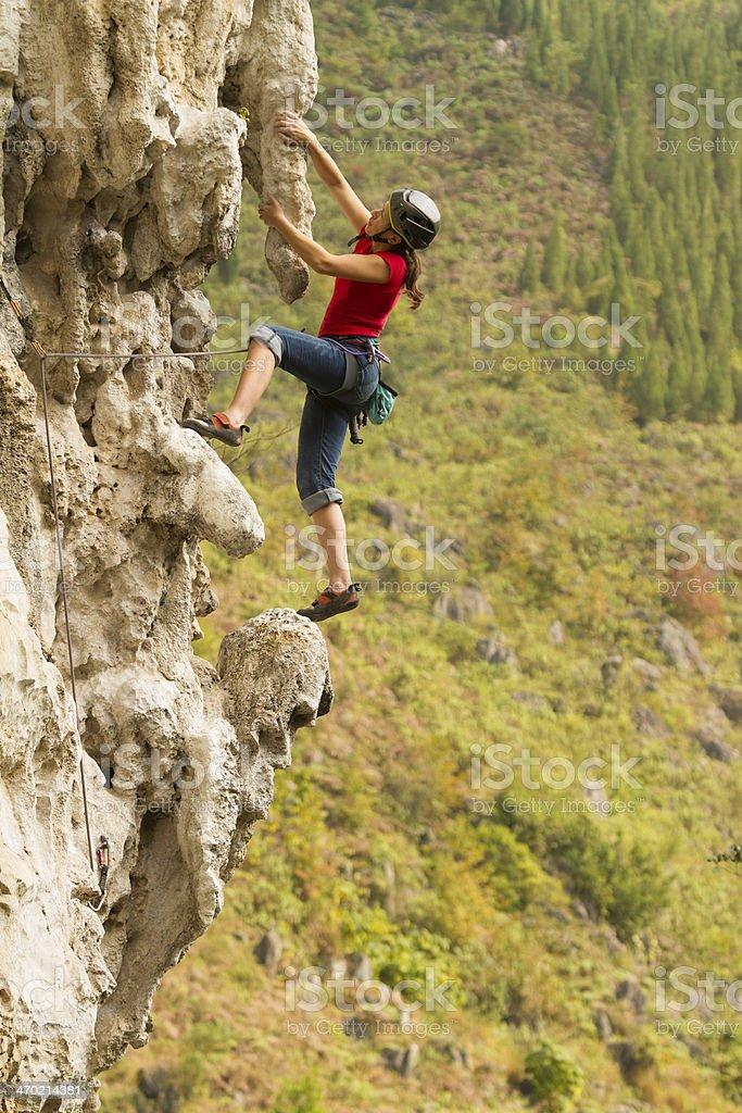 Woman rockclimbing in China royalty-free stock photo